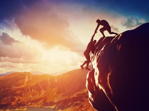 bigstock-Hikers-climbing-on-rock-mount-66403036-300x225